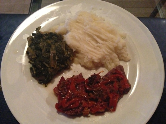 grilled venison covered with red peppers and sweet onion, homemade mashed potatoes, and sauteed greens
